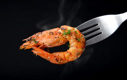 Grill Shrimp BBQ style . Grill Shrimp BBQ style mixed spicy ,ingredient set in black backgrount with smoke in studio lighting stock image