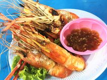 Grill shrimp with spicy sauce. Delicious spicy food from Thailand Royalty Free Stock Image