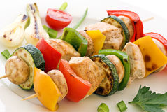 Grill Skewer. With chicken and vegetables as closeup on a white plate Royalty Free Stock Image