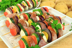 Grill skewer preparation Stock Photos