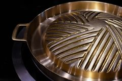 Brass hotpot pan for grill and soup Royalty Free Stock Images