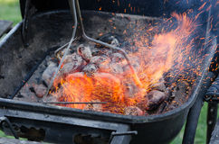 Grill sparks flying. Grilling outside, with coal grill Stock Photos