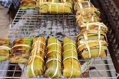 Grill of spice pork inside banana leave Stock Image