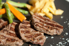 Grill steak with patties. And vegetables Royalty Free Stock Photos