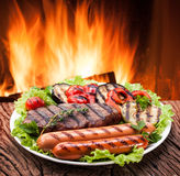 Grill: steak, sausage and vegetable on a plate. stock photos