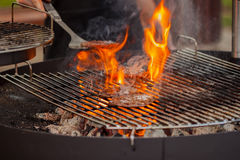 Grill , strong burning flame, patties for burgers Stock Images