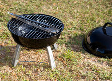 Grill with Tongs Stock Images
