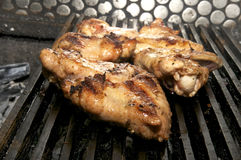 Grill the wings Stock Images