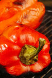 grilla röda peppar Fotografering för Bildbyråer