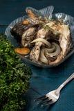 Grillad fisk i sås och kryddor Royaltyfria Bilder