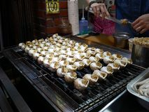 Grillad mat för havssnigel royaltyfria foton