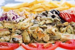 Grillad meat with mushrooms. Stock Photos