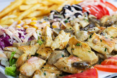 Grillad meat with mushrooms. Royalty Free Stock Photo