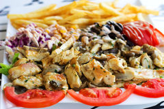 Grillad meat with mushrooms. Royalty Free Stock Images