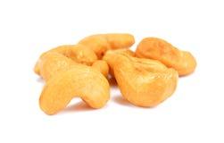 grillad stapel för cashewmuttrar Grupp av cashewlmuttrar Nust isolat Fotografering för Bildbyråer