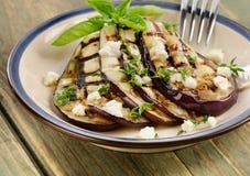 Grillade aubergineskivor på en platta Fotografering för Bildbyråer
