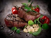 Grillade bbq-steaks Arkivfoton