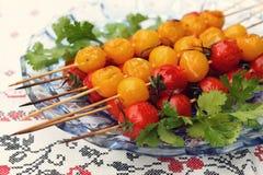 Grillade körsbärsröda tomater Arkivbild