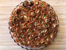 Grillade körsbärsröda tomater, läcker vegetarisk mat arkivbild