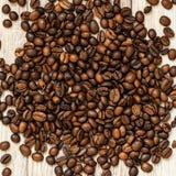 Grillade kaffebönor, kan användas som en bakgrund Makro för textur för kaffebönor Fotografering för Bildbyråer