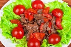 Grillade nötkött och champinjoner Arkivbild