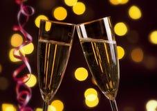Grillage avec le champagne le réveillon de la Saint Sylvestre Image stock