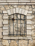 Grille. Against the background of stone wall stock images