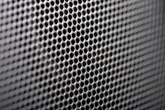 Grille background. Grille of speaker close-up horizontal photo. Focus on center image Stock Image
