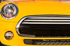 Grille bumper and headlights of yellow sport car Stock Photo