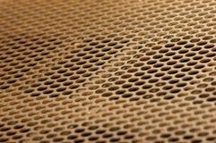 Grille d'or en métal Images stock