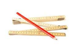 Grille de tabulation de pliage et crayon de charpentiers image stock