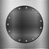 Grille grise en métal et plat noir de cercle Photo stock
