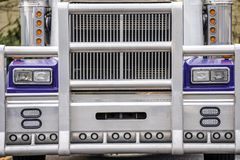 Grille guard and front part of big rig classic blue powerful semi truck stock photo