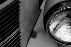 Grille and Headlight of Classic Car Stock Photography