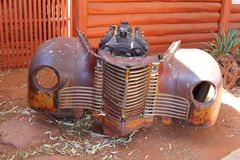 Grille and motor block of a rusty car wreck, Lasseter Highway, Australia Royalty Free Stock Image