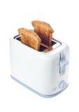 Grille-pain avec des parts de pain Photos libres de droits