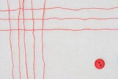 Grille rouge et bouton de fil Photographie stock