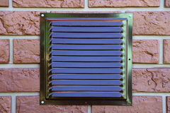 Grille for ventilation in the brick wall of the house.  Royalty Free Stock Photography