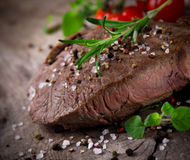 Grilled 500g bbq steak. On wooden table Royalty Free Stock Images