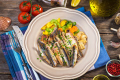 Grilled anchovy. On wooden background Stock Image