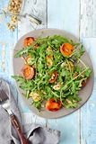Grilled apricot and halloumi salad stock photo