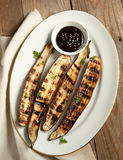 Grilled Asian long eggplant with Hoisin sauce. On plate stock photo