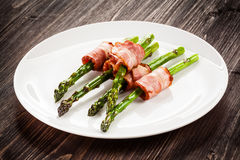 Grilled asparagus with beacon. Grilled aparagus and beacon on white plate Stock Photo