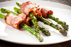Grilled asparagus with beacon. Grilled aparagus and beacon on white plate Royalty Free Stock Photos