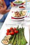Grilled asparagus with cherry tomatoes Stock Photo