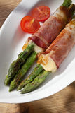 Grilled asparagus with ham and cheese Stock Photo