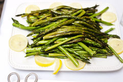 Grilled Asparagus with Lemon Wedges Royalty Free Stock Images