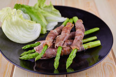 Grilled asparagus with Parma ham Royalty Free Stock Photo