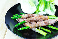 Grilled asparagus with Parma ham Royalty Free Stock Image