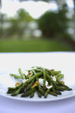 Grilled Asparagus with walnuts and goat cheese. On a white plate Royalty Free Stock Photography